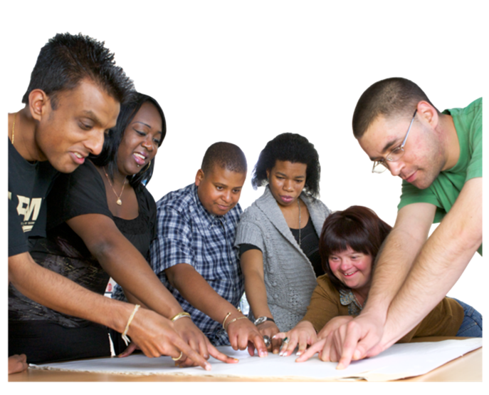 Group of Black, Asian and white Disabled people of different ages and genders. Everyone is pointing to a piece of paper on a table.